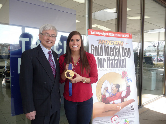 Chin Lee poses for a photograph with Scarborough's Natalie Spooner who won a Gold Medal with the Canadian Women Hockey Team at the 2010 Winter Olympics in Vancouver.